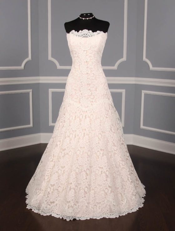 This lace Romona Keveza Legends L503 wedding dress is Brand New!  The gown has ivory re-embroidered lace and blush lining.  Such an elegant color combination!  This Romona Keveza strapless wedding gown has a scalloped neckline and hem, an a-line silhouette and a chapel train.